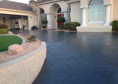 black cobblestone concrete driveway