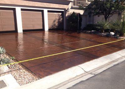 dark brown driveway concrete