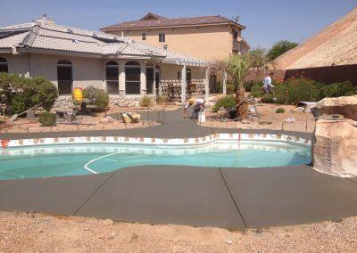 laying concrete around pool